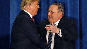 FILE - In this March 3, 2016, file photo, Republican presidential candidate Donald Trump is welcomed to the stage by Maine Gov. Paul LePage, in Portland, Maine. LePage has floated the idea he could play a role in a Trump presidency, a move that might benefit the state's Senate president, a fellow Republican with whom he has had a tepid relationship .(AP Photo/Robert F. Bukaty, File)